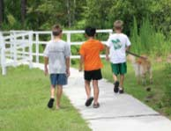 Some children walk a dog in one of Carolina Forest's many neighborhoods